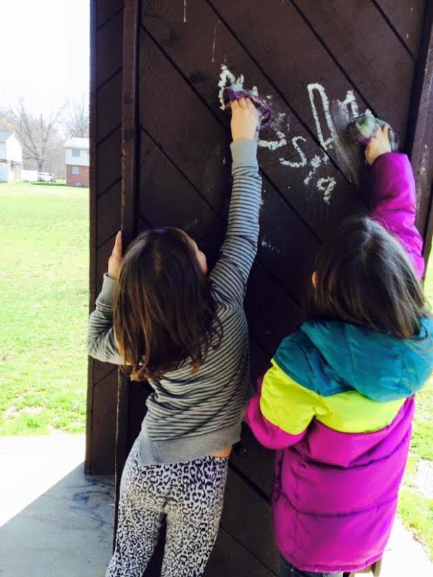 Little Girls Clean Graffiti